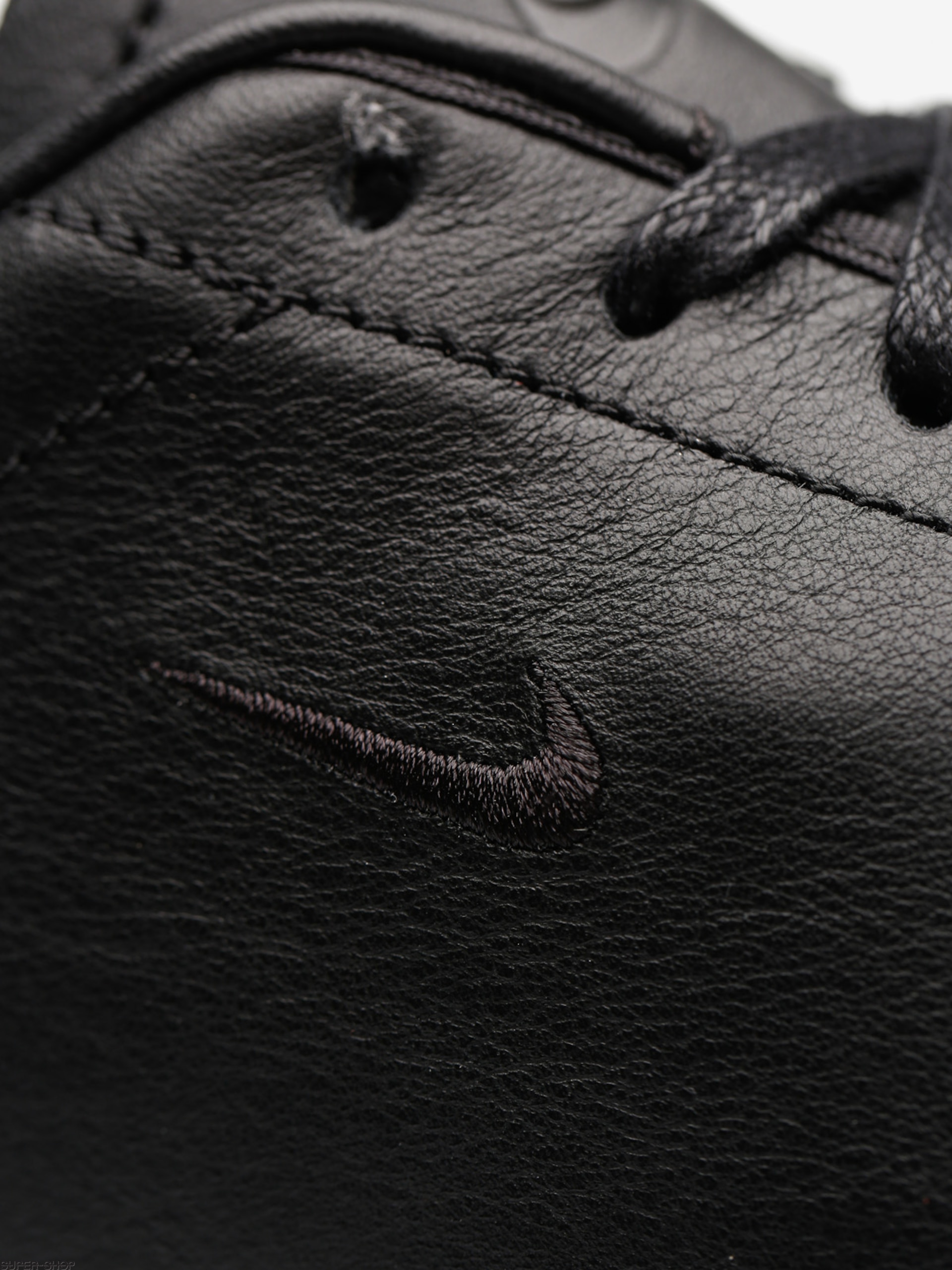 all black nike leather shoes